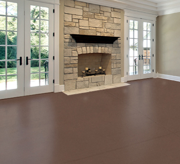Picture of living room fireplace with stained concrete floor.